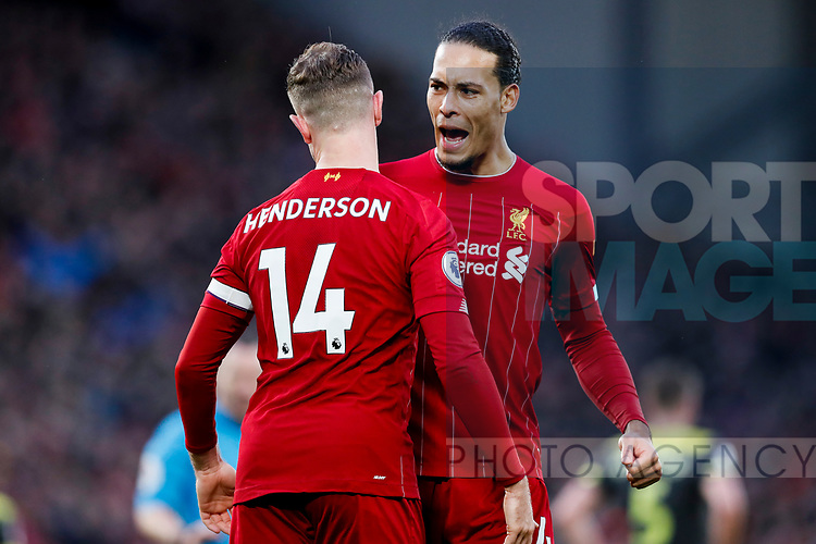 Jordan Henderson of Liverpool celebrates with Virgil Van Dijk after scoring the second goal of the game during the Premier League match at Anfield, Liverpool. Picture date: 1st February 2020. Picture credit should read: James Wilson/Sportimage
