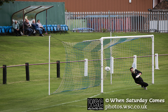 Whitehill Welfare 4 Gala Fairydean Rovers 2, 10/08/2013. Ferguson Park, Scottish Lowland Football League. Gala Fairydean Rovers goalkeeper cannot prevent his team going 2-0 down during his team's inaugural match in the Scottish Lowland Football League away to Whitehill Welfare at Ferguson Park. Gala were formed in 2013 by an a re-amalgamation of Gala Fairydean and Gala Rovers, the two clubs having separated in 1908 and Gala's Netherdale ground in Galashiels in the Scottish Borders had one of only two stands designated as listed football stands in Scotland. Whitehill won the match, the first-ever in the newly-formed Lowland League by 4 goals to 2. Photo by Colin McPherson.