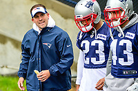June 6, 2017: New England Patriots offensive coordinator Josh McDaniels (left) talks to safety Patrick Chung (23) and defensive back Nate Ebner (43) on the way to practice in the rain at the New England Patriots mini camp held on the practice field at Gillette Stadium, in Foxborough, Massachusetts. Eric Canha/CSM
