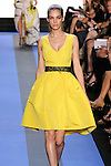 Samantha walks runway in a cadmium yellow faille v-neck hi-low cocktail dress, by Monique Lhuillier, from the Monique Lhuillier Spring 2012 collection fashion show, during Mercedes-Benz Fashion Week Spring 2012.