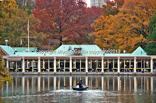 A row boat on the Lake with the Loeb Boathouse in the background; Autumn in New York City Central Park