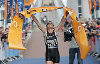 30 JUL 2006 - SALFORD, UK - Samantha Warriner (NZL) celebrates winning the Elite Womens race at the Salford ITU World Cup triathlon. (PHOTO (C) NIGEL FARROW)