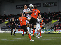 Sam Parkin and Jon Daly challenge in the air watched by Sean Dillon in the St Mirren v Dundee United Clydesdale Bank Scottish Premier League match played at St Mirren Park, Paisley on 27.10.12.