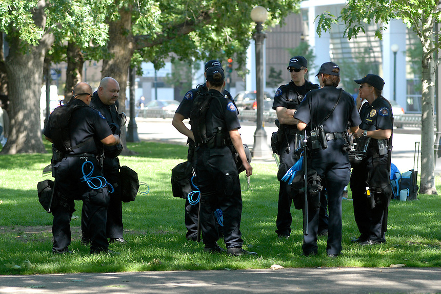 24 Aug 08: A group of police personnel outfitted in riot gear prior to a planned march from the Colorado state capitol building to the Pepsi Center. On the day before the Democratic National Convention is scheduled to begin about 1,500 people participated in the ReCreate 68 rally, which included a march from the Colorado state capitol building to the Pepsi Center.