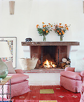A raised open fire is situated at one end of the sitting room located on the upstairs landing