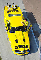 Apr. 28, 2012; Baytown, TX, USA: Aerial view of NHRA pro mod driver Troy Coughlin during qualifying for the Spring Nationals at Royal Purple Raceway. Mandatory Credit: Mark J. Rebilas-