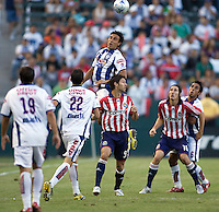 Pachuca defender Fausto Pinto (21) goes high for a ball. Pachuca CF defeated the Chivas USA 2-1 during the 1st round of the 2008 SuperLiga at Home Depot Center stadium, in Carson, California on Sunday, July 13, 2008.