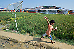 A Rohingya boy flies a kite in the Jamtoli Refugee Camp near Cox's Bazar, Bangladesh. <br /> <br /> More than 600,000 Rohingya have fled government-sanctioned violence in Myanmar for safety in Bangladesh.