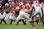 Wisconsin Badgers offensive linemen Peter Konz (66) and Kevin Zeitler (70) double team a defender as quarterback Scott Tolzien (16)hands the ball to running back John Clay (32) during an NCAA college football game against the Ohio State Buckeyes on October 16, 2010 at Camp Randall Stadium in Madison, Wisconsin. The Badgers beat the Buckeyes 31-18. (Photo by David Stluka)
