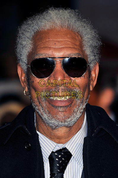 "MORGAN FREEMAN .Attending the ""Invictus'"" UK Film Premiere at the Odeon West End cinema, Leicester Square, London, England, January 31st, 2010..arrivals portrait headshot beard sunglasses facial hair smiling aviators black tie grey gray hoop earring .CAP/PL.©Phil Loftus/Capital Pictures"