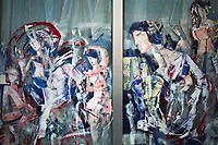 Italy. Liguria Region. San Remo. Town center. A store window is covered with artistic paintings. Close up of a vacated shop painted window. Liguria is a region of north-western Italy. Sanremo or San Remo is a city and comune in the Province of Imperia. 20.07.2020 © 2020 Didier Ruef