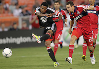 WASHINGTON, DC. - AUGUST 22, 2012:  Lionard Pajoy (26) of DC United blasts a shot past  Austin Berry (22) of the Chicago Fire during an MLS match at RFK Stadium, in Washington DC,  on August 22. United won 4-2.