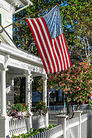 Charming home exterior with American flag, Woodstock, Vermont, USA.