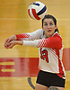 Caleigh McDermott #13 of St. John the Baptist makes a dig during a CHSAA varsity girls volleyball match against Sacred Heart Academy at St. John the Baptist High School in West Islip on Thursday, Oct. 12, 2017. Sacred Heart won the match 3-0.