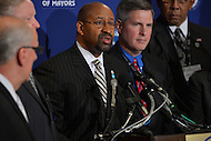 January 17, 2013  (Washington, DC)  President of the U.S. Conference of Mayors (USCM), Mayor Michael Nutter (center), holds a news conference at the opening of the USCM 81st winter meeting at the Capitol Hilton in Washington.   (Photo by Don Baxter/Media Images International)