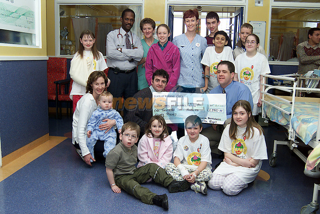 Brian Keelan and Rory Everitt from the Drogheda Bartenders Social Club presenting a cheque for £1,200 for the Childrens Ward in the Lourdes Hospital. Also pictured are staff and children from the ward..Picture: Paul Mohan/Newsfile