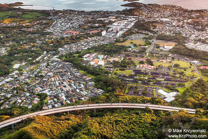 "An aerial view of Kaneohe & H-3 freeway at dawn from Haiku Stairs (""Stairway to Heaven"") hiking trail in Kaneohe, Oahu"