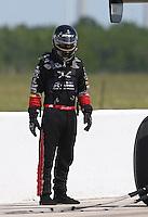 Apr. 28, 2013; Baytown, TX, USA: NHRA top fuel dragster driver Spencer Massey during the Spring Nationals at Royal Purple Raceway. Mandatory Credit: Mark J. Rebilas-