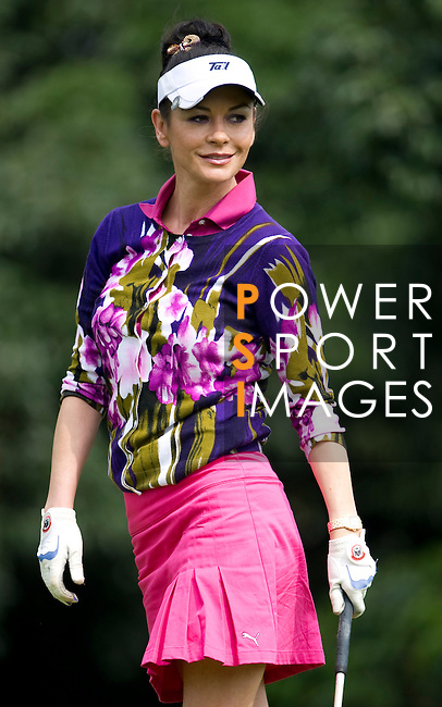 HAIKOU, CHINA - OCTOBER 29:  Hollywood actress Catherine Zeta-Jones smiles on the 8th tee during day three of the Mission Hills Start Trophy tournament at Mission Hills Resort on October 29, 2010 in Haikou, China. The Mission Hills Star Trophy is Asia's leading leisure liflestyle event which features Hollywood celebrities and international golf stars. Photo by Victor Fraile / The Power of Sport Images
