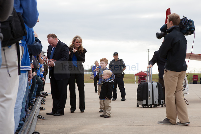 New University of Kentucky head football coach Mark Stoops and family at the R.J. Corman Hanger in Nicholasville, Ky on December 2, 2012. Photo by Adam Chaffins | Staff
