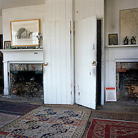 A demolished wall previously divided two properties which explains why the present drawing room has two fireplaces and two doors so close to each other