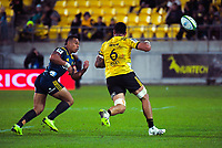 Tevita Li closes in on Vaea Fifita as he loses the ball during the Super Rugby match between the Hurricanes and Highlanders at Westpac Stadium in Wellington, New Zealand on Friday, 1 March 2019. Photo: Dave Lintott / lintottphoto.co.nz
