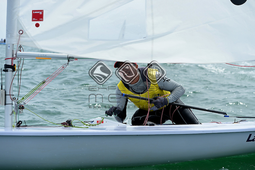 Laser gold medal race / Colin Cheng (SIN) Gold medalist<br /> ISAF Sailing World Cup - Melbourne<br /> St Kilda sailing precinct, Victoria<br /> Port Phillip Bay Sunday 13 Dec 2015<br /> &copy; Sport the library / Jeff Crow