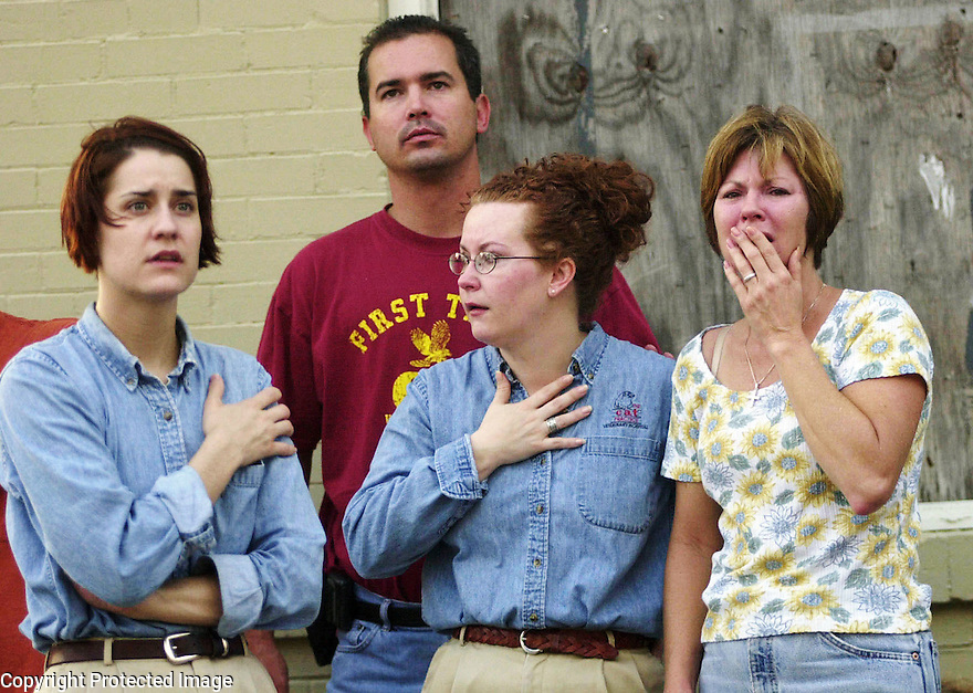 Shocked employees look at the fire at the Cat Practice where several pets perished in the early morning fire.