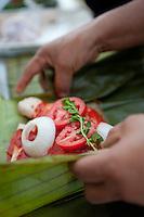 Making pollo pibil La Finca Puc, Muna, Yucatan, Mexico