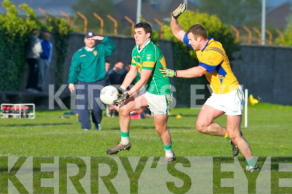 John Mitchels Bryan Costello and Finuge's John McCarthy in action in the Intermediate Championship at Boherbue, Tralee on Saturday.
