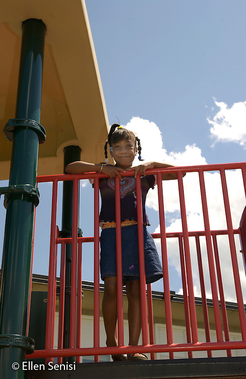 MR/Schenectady, NY.Yates Arts In Education Magnet School.Grade one/ two (split).Girl (6, grade 1, African American) on  playground at recess..MR: Bre4.©Ellen B. Senisi