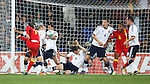 No way through for Joe Allen as the Scotland defence holds and Gary Caldwell slides in