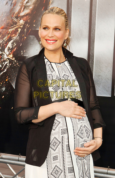 Molly Sims.Premiere of 'Battleship' held at Nokia Theatre L.A. Live in Los Angeles, California, USA..May 10th, 2012.half length black blazer jacket sheer sleeves white dress print pregnant .CAP/ROT/TM.©Tony Michaels/Roth Stock/Capital Pictures