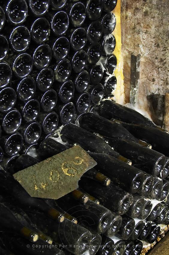 pile of bottles dom rossignol trapet gevrey-chambertin cote de nuits burgundy france