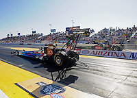 Feb. 17 2012; Chandler, AZ, USA; NHRA top fuel dragster driver Cory McClenathan (near lane) races alongside Terry McMillen during qualifying for the Arizona Nationals at Firebird International Raceway. Mandatory Credit: Mark J. Rebilas-