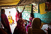 Women gather to seek medical consultancy at the delivery hut in Barwa village of East Champaran district of Bihar, India. Initiated to provide better pre-natal care to the pregnant women, Duncan Hospital with collaboration with Geneva Global has initiated a special campaign - delivery hut. Villagers here are told about various health issues, women go through free pre-natal check ups etc. Since 2008 the Foundation and Geneva Global have been investing in the training of medical staff to improve the lives of people living in 600+ villages in the region. The NGOs are delivering cost effective interventions to address treatment, care and prevention of diseases, disability and preventable deaths amongst infants, adolescent girls and women of child-bearing age. There is statistical and anecdotal evidence that there have been vast improvements and a total of 40-50% increased immunization for all children under 6 has meant that communities can be serviced and educated long term. Photograph: Sanjit Das/Panos for Legatum Foundation