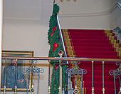 "The 2017 White House Christmas decorations, with the theme ""Time-Honored Traditions,"" which were personally selected by first lady Melania Trump, are previewed for the press in Washington, DC on Monday, November 27, 2017.  This is a view looking up the Grand Staircase going to the Residence.  Next to the staircase is the official portrait of former US President Gerald R. Ford.<br /> Credit: Ron Sachs / CNP"