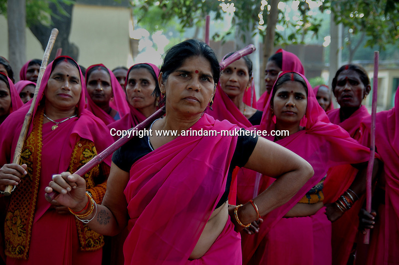 Sampat Pal Devi and her Gulabi Gang. Sampat pal Devi the commander of Gulabi Gang fights for women empowerment, justice and rights among the poor people of Bundelkhand region of Uttar Pradesh. Sampat Pal Devi comes from a poor family in Bundelkhand - the poorest region of India. The region is fraught with abject poverty, gross under development, lack of law and order, and stark casteism in which the Brahmins and other higher caste people treat their low caste brethren with disdain. Out of such situation when Sampat Pal Devi decided to speak up for the poor, she has been winning heart felt gratitude of the poor as well as enmity of the high caste people and grudging respect of the law enforcement officials who used to be largely inactive in these badlands of North India. Initially, she began with helping distressed women - victims of domestic violence and dowry system, but soon started getting other cases of nature of land dispute and under development. She emerged as a fiery leader in 2007, when she beat up the OC of the local police station while demanding release of a dalit woman kept locked up in the cell for thirteen days without being charged with a case.Today, she has a huge fan following of some 25 hundreds of thousands of women (spread across 8 districts of the state of UP) who have come to be known as Gulabi Gang or Pink Vigilante Women for their vibrant pink sarees - the costume of the gang; and fiery nature of dealing with injustice. When verbal negotiations for justice fail they resort to beating up. Sampat Devi is viewed as a messiah with the promise of bringing back law and order for the poor, in these mafia troubled areas. Today, perpetrators are simply scared of her as she does not hesitate to challenge law and order and even system - to win justice for the poor. More complaints related to domestic violence and other problems are registered now with the police than they ever used to be. She being one of the Other Backward Caste people in the region i