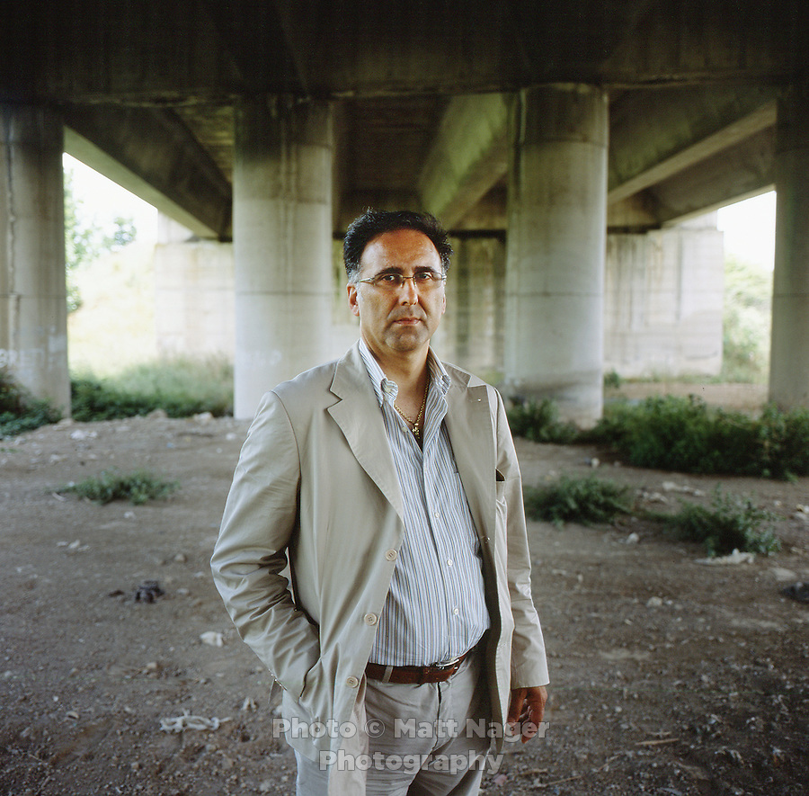 Genarro Esposito (cq), an environmental activist, doctor, and member a non-profit organization called Doctors for the Environment stands under a bridge where toxic waste has been buried Saturday, June 19, 2010. Esposito, who lives in Marigliano, has worked for several years documenting and uncovering waste sites and looking into health issues that result from contamination...PHOTOS/ MATT NAGER