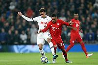 Corentin Tolisso of Bayern Munich and Dele Alli of Tottenham Hotspur during Tottenham Hotspur vs FC Bayern Munich, UEFA Champions League Football at Tottenham Hotspur Stadium on 1st October 2019