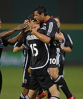 DC United forward Rod Dyachenko (15) celebrates with team mate midfielder Christian Gomez  (10) after scoring the only goal of the game in the 12th minute of play. DC United defeated Club America 1-0 to secure one of the two semifinal berths in SuperLiga group B, at RFK Stadium in Washington DC, Sunday July 29, 2007.