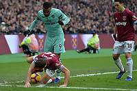 Mark Noble of West Ham United is tackled by Alexandre Lacazetten of Arsenal during West Ham United vs Arsenal, Premier League Football at The London Stadium on 12th January 2019