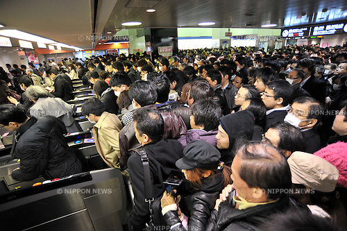 March 17, 2011, Tokyo, Japan - A horde of passengers and commuters crowed at TokyoÅfs Ikebukuro station as railway operators reduce or suspend services in power rationing on Wednesday, March 16, 2011. Tokyo Electric Power Co. began its first-ever rolling blackout from Monday to help prevent an unexpected large-scale power outage after a powerful earthquake shut two nuclear plants indefinitely on Friday. (Photo by Natsuki Sakai/AFLO) [3615] -mis-