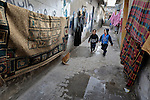 Children walking in the Nuseirat refugee camp in the middle of the Gaza strip. .
