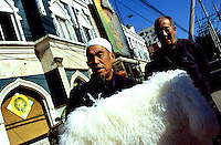 CHINA. Beijing. A man selling goods in the Muslim district of 'Niu Jie'. 2005