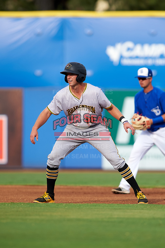 Bradenton Marauders designated hitter Jordan George (10) leads off second base in front of Dunedin Blue Jays shortstop J.C. Cardenas (2) during a game against the Dunedin Blue Jays on July 17, 2017 at Florida Auto Exchange Stadium in Dunedin, Florida.  Bradenton defeated Dunedin 7-5.  (Mike Janes/Four Seam Images)