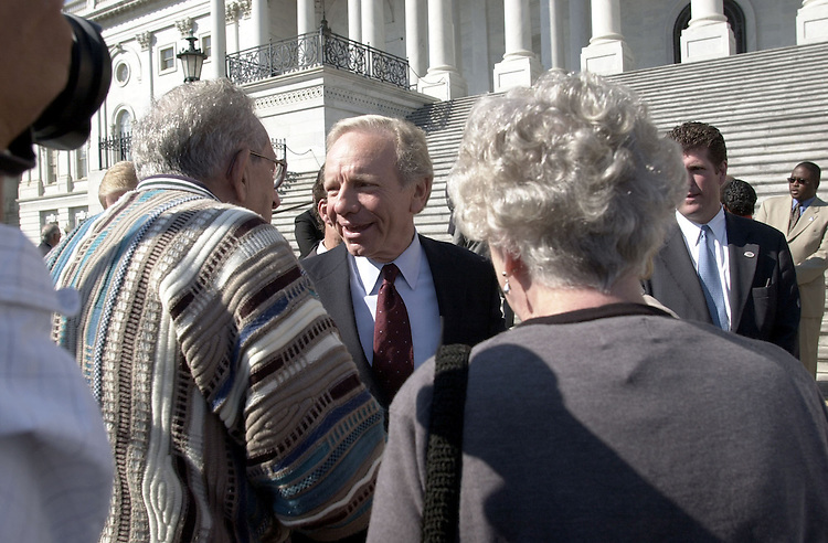LiebermanJ.9(DG)092800 -- Joseph I. Lieberman, D-Conn., talks with senior citizens about RX drugs after a press conference on the U.S. Capitol East Front steps on RX drugs.