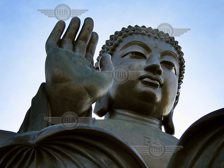 The bronze Tian Tan Buddha statue at Po Lin monastery and temple complex on Lantau Island.  It is the world's largest outdoor seated bronze Buddha statue, and is a major centre of Buddhism in the city...