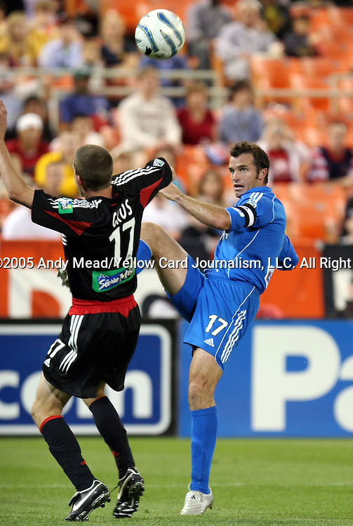 21 May 2005: Chris Klein (right) lofts the ball over Joshua Gros (left). DC United defeated the Kansas City Wizards 3-2 at RFK Stadium in Washington, DC in a regular season Major League Soccer game. . .