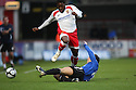 Yemi Odubade of Stevenage Borough is tackled by Phil Cave of Gateshead during the Blue Square Premier match between Stevenage Borough and Gateshead at the Lamex Stadium, Broadhall Way, Stevenage on Saturday 14th November, 2009  .© Kevin Coleman 2009